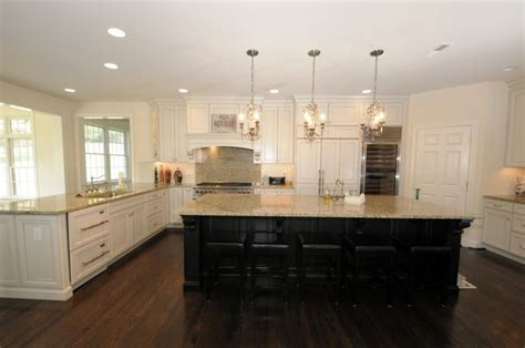 white kitchen dark island off white cabinets with dark island same as our kitchen