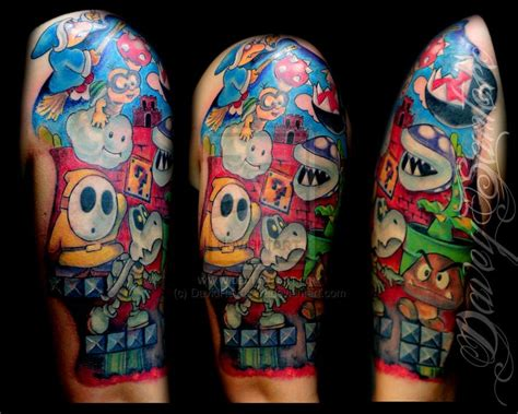 nintendo sleeve tattoo designs 25 amazing tattoos inkdoneright