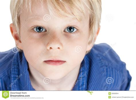 close up portrait of cute young boy stock image image portrait of a serious young boy stock images image 26929304