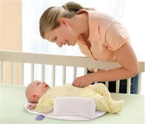 how to stop baby rolling around in cot mothercare and tesco pull baby sleep positioners from