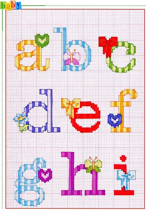 schemi punto croce farfalle e fiori alfabeto punto croce con fiocchi fiori e farfalle 1