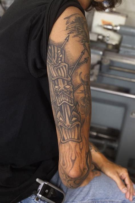 right arm tattoos grey ink tikki on right arm