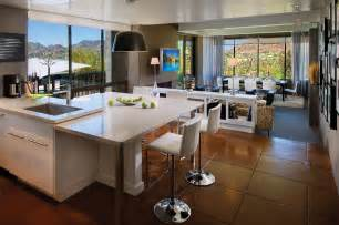 big brown tile floor combined with white wooden kitchen set plus stools also table plus shelf