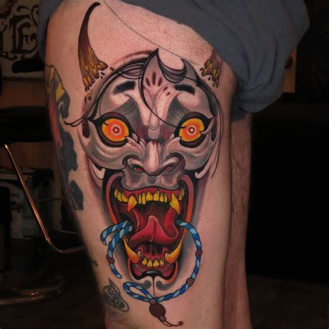 tattoo hannya mask traditional women face with snake tattoo on man chest