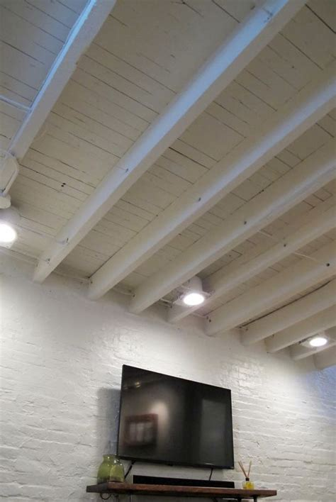 raising basement ceiling exposed ceiling in a shallow basement paint the rafters