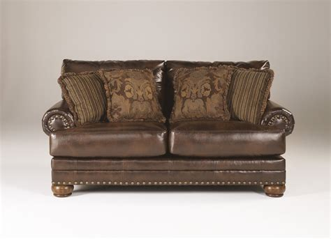 ashley leather loveseat ashley brown leather durablend antique sofa by ashley