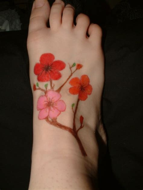 cherry blossom foot tattoo designs 30 delicate cherry blossom tattoos ideas webdesignlayer