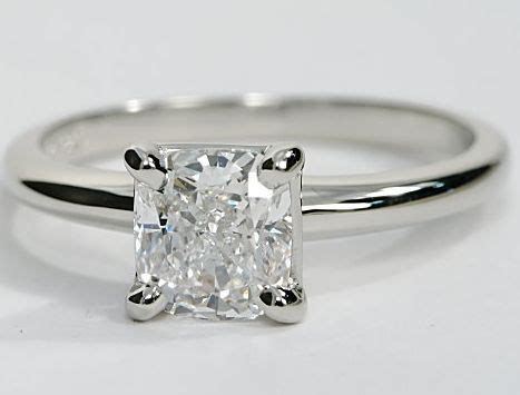 simple and this solitaire engagement ring in