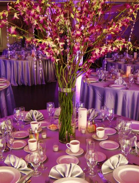 centerpieces with purple dendrobium orchids curly willow