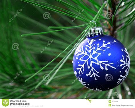 blue christmas bulb on tree stock images image 1535524