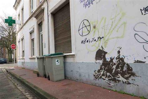 banksy creates  pieces  calais france