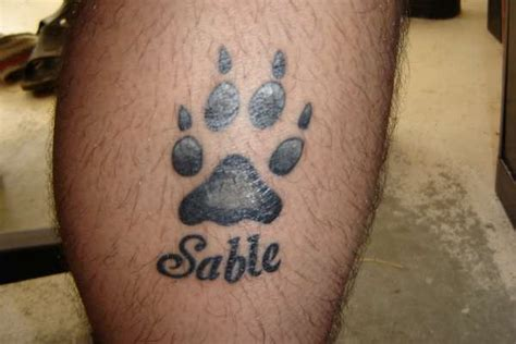 dog print tattoo designs 15 playful paw tattoos me now