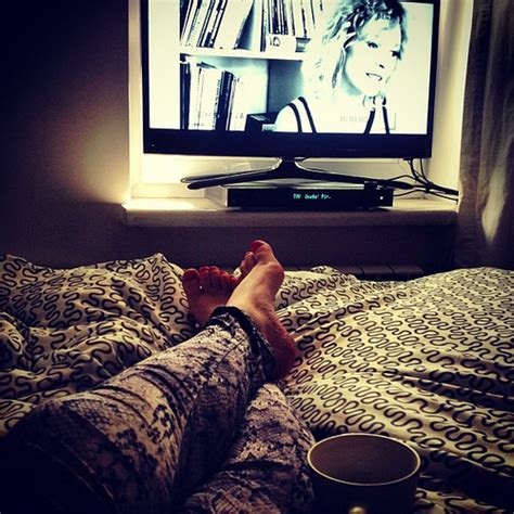 watching tv in bed cozy bed watching smarttv tv tea lazy sunday sams