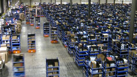 Amazon Warehouse Robots | amazon warehouse demand devours robots and workers
