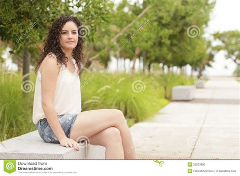 sitting park bench woman sitting on a park bench stock photo image 20023880