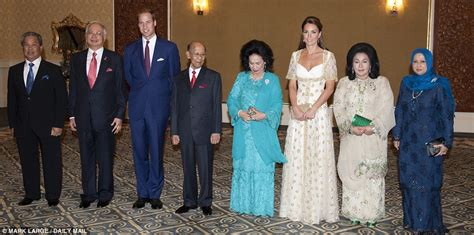 Batik Princess Mahkota kate middleton glitters in glamorous gold at opulent state