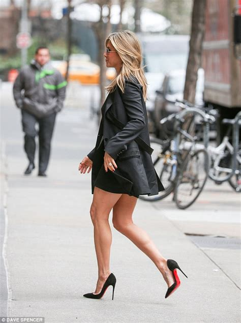 while the miniskirt has been jennifer aniston keeps it simple but sexy in black dress
