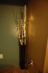 floor vase with birch branches and lighted branches on a