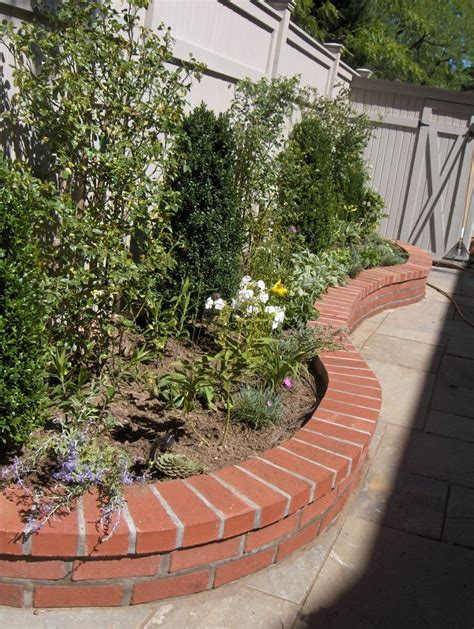 brick wall garden backyard flower bed buildouts pinterest gardens brick garden and colors