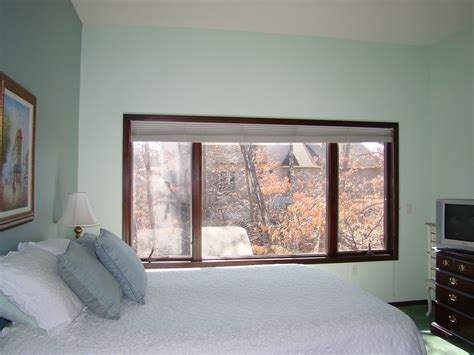 pictures of bedroom windows before after window treatments that camouflage a