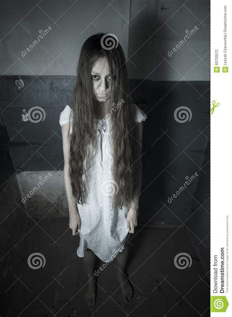 0007232799 black girl white girl horror girl in white dress stock photo image of human