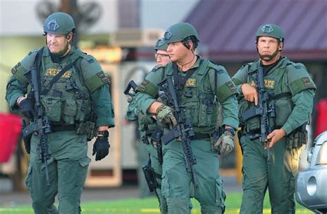 louisiana state officers leave the location where three officers were dead in