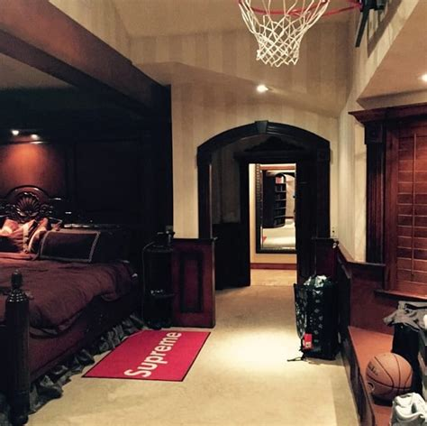 basketball hoop for bedroom drake s bedroom is decorated with a supreme rug and a