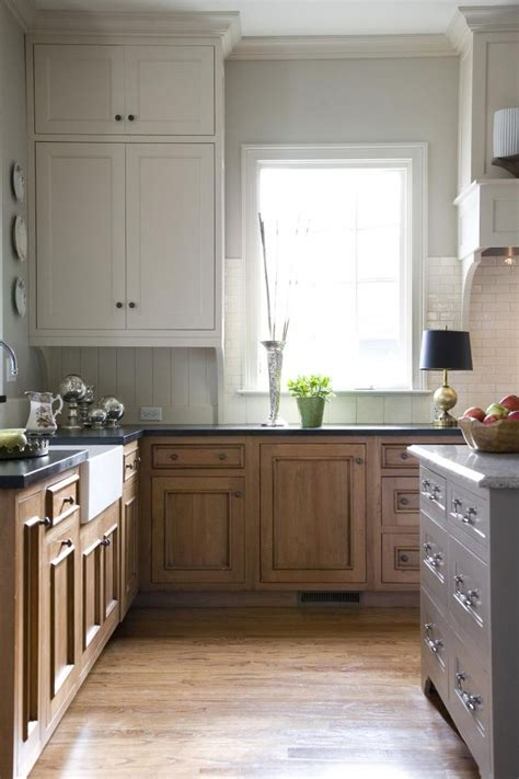 white stained kitchen cabinets white uppers and stained lowers in kitchen by jean stoffer