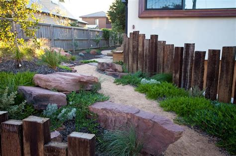 Australian Garden Ideas Recycled Sleeper Retaining Wall And Screen Matched With Australian Natives Phillip Johnson