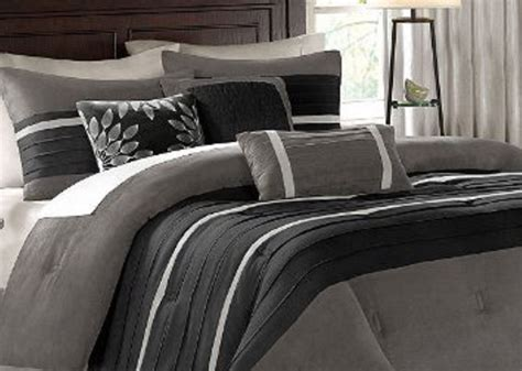 bedroom black and gray comforter with sham on grey bed