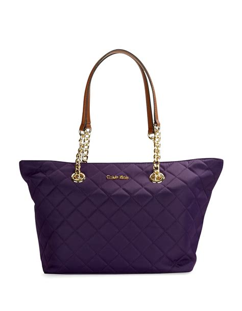 calvin klein quilted small satchel tote in blue lyst