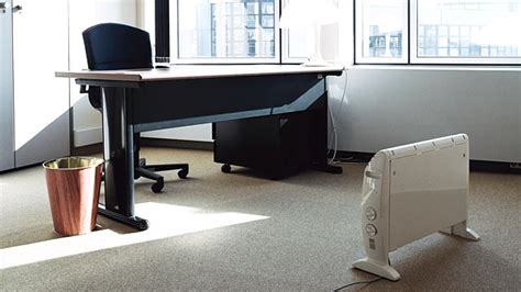 under desk space heater five ways to stay warm in a blistering cold air