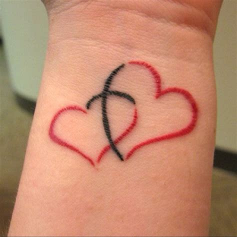 heart tattoo with couple inside cross inside of a heart piercings tats pinterest