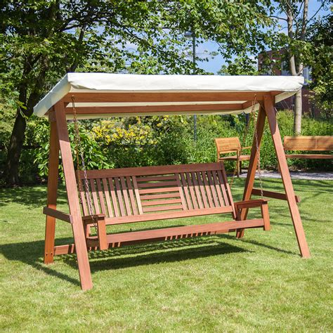 outdoor wooden swing alfresia wooden outdoor swinging hammock 3 seater swing