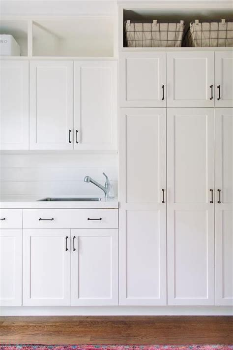 white laundry room cabinets all white laundry room features white shaker cabinets