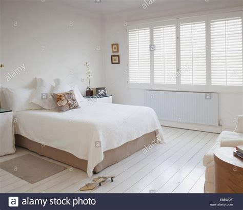 bedroom shutters white bedcover on bed in white bedroom with plantation