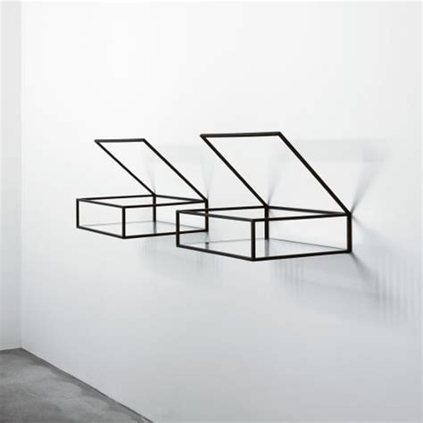 minimalist shelves with black enameled brass frame and the
