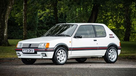 peugeot 205 gti peugeot 205 gti raises eyebrows at silverstone