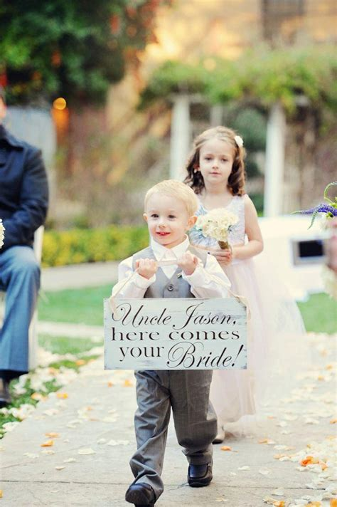 flower ring bearer and flower with sign