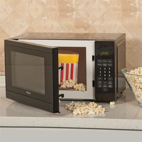 Microwave Haier haier hmc720beww 0 7 cu ft countertop microwave with 700