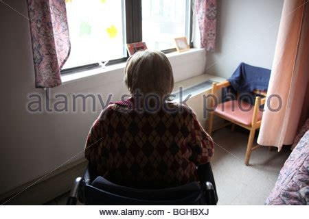 looking out from my lonely room depressed lonely elderly by window squander waste dissipate stock photo royalty free