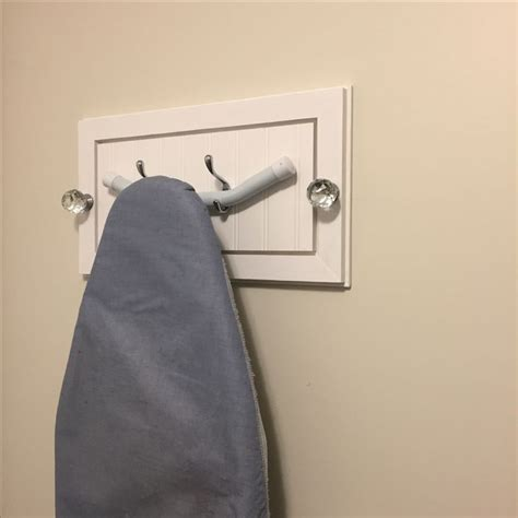 The Door Ironing Board Hanger by 1000 Ideas About Ironing Board Hanger On