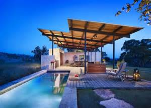 Open air story pool house by lake flato