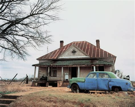 Abandoned Car In Front Of House by William Christenberry S Evocation Of The American South In New New York Exhibition