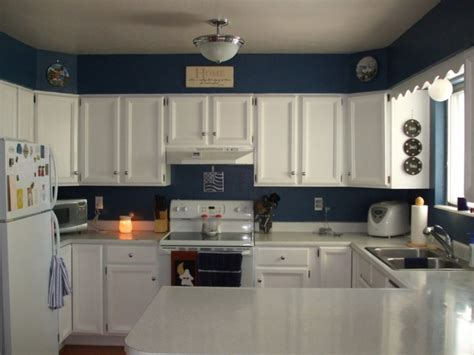 blue wall color with classic white kitchen cabinet for