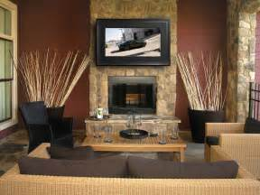 mirror tv above fireplace
