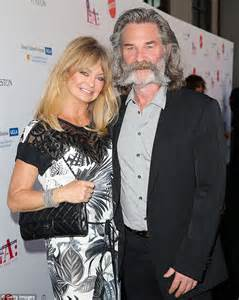 christopher russell and kurt russell goldie hawnchecks on the construction of her home while