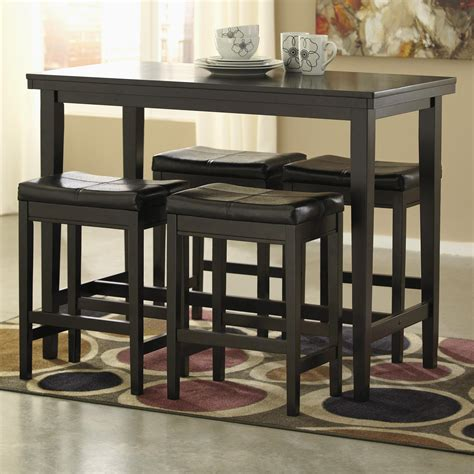 Counter High Table With Stools 5 counter table set with brown upholstered