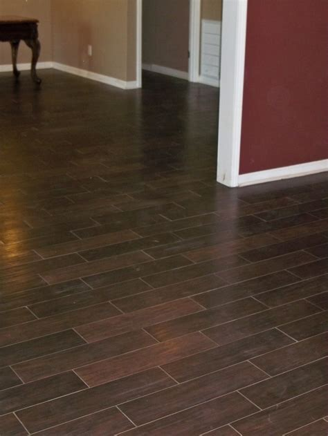 ceramic tile on basement floor wood look tile installed in a basement in n forsyth co