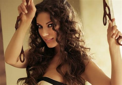 girl with brown curly hair and toplwss coming out of the water at the beach 40 hairstyles for curly hair which look great creativefan